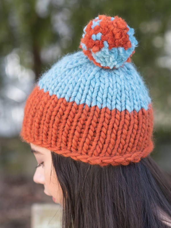 Simple hat Carver with a fun multi color pom pom. Free knitting pattern.