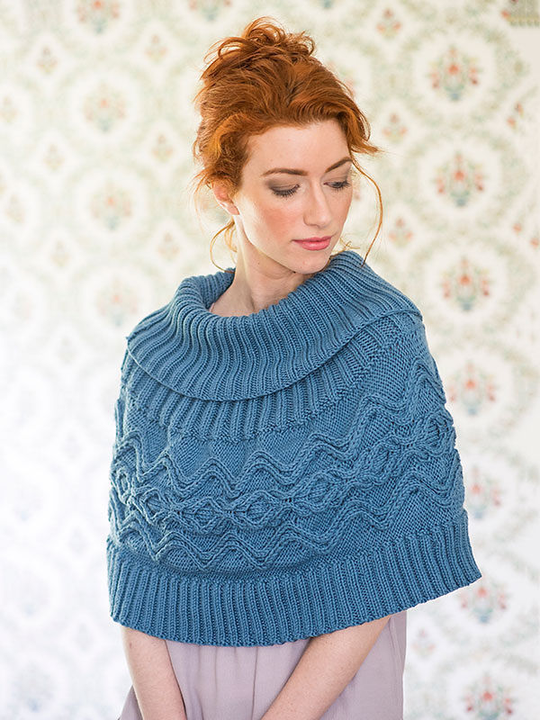Women's cable poncho River. Free knitting pattern.