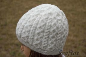 Girls winter beanie. Back left view.