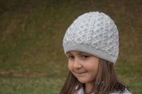 Girls winter beanie. Front left view.