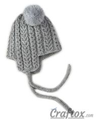 Knitting winter hat with pom poms for child. Right view.
