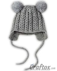 Knitting winter hat with pom poms for child. Front view.