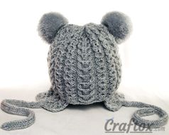 Knitting winter hat with pom poms for child. Back view.