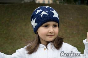 Slouchy beanie with stars. Front right view.