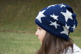 Slouchy beanie with stars. Left view.