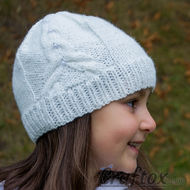 Free knitting pattern for white beanie with tower.