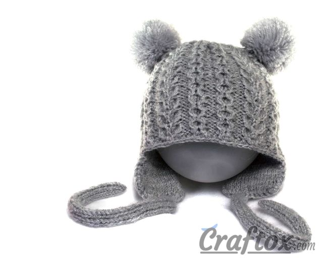 Knitting winter hat with pom poms for kid. Free pattern